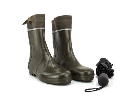 Wellington boots with umbrella on white background photo
