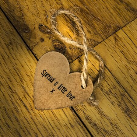 Spread a little love message on a wooden floor photo