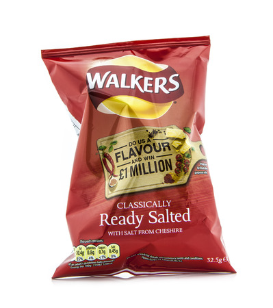 packets: SWINDON, UK - FEBRUARY 1, 2014: Packet of Walkers ready salted crisps on a white background
