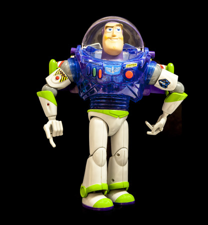 SWINDON, UK - FEBRUARY 19, 2014: Buzz Lightyear from Disneys Toy Story 2 on a Black Background