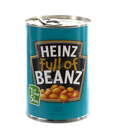 SWINDON, UK - FEBRUARY 24, 2014: Can of Heinz baked beans isolated on a white background. Heinz Company manufactures thousands of food products in plants on six continents.