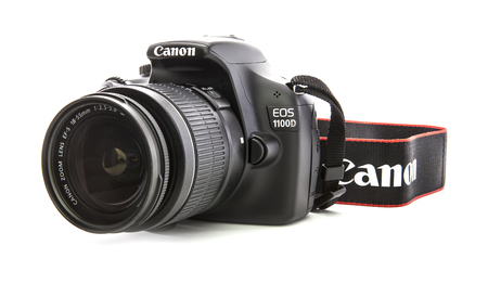 SWINDON, UK - FEBRUARY 16, 2014: Canon 1100D DSLR Camera on a white background