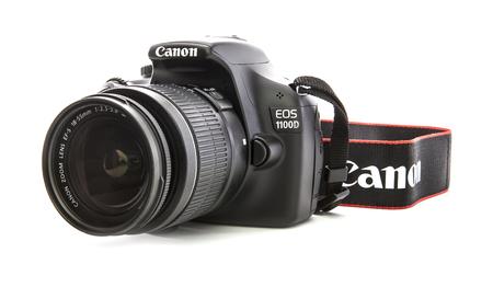 eos: SWINDON, UK - FEBRUARY 16, 2014: Canon 1100D DSLR Camera on a white background
