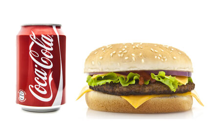 SWINDON, UK - FEBRUARY 22, 2014: Coca-Cola and Cheeseburger on a white background