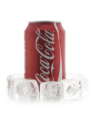 SWINDON, UK - FEBRUARY 2, 2014: Can of Coca-Cola on ice over a white background