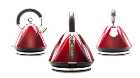 SWINDON, UK - FEBRUARY 16, 2014: Three electric kettles on white background