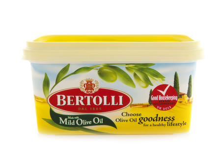 SWINDON, UK - FEBRUARY 1, 2014:  Tub of Bertolli Vegtable Spread with oOlive Oil on a white background Editorial