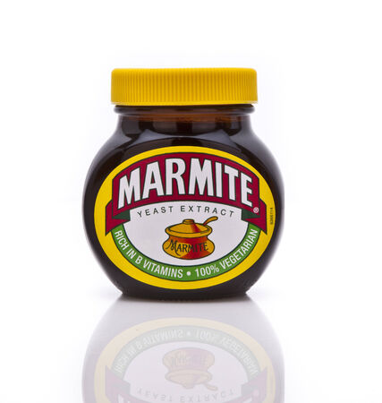 SWINDON, UK - FEBRUARY 18, 2014: Jar of Marmite on a white background Publikacyjne