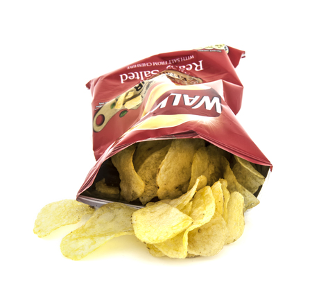 crunchy: SWINDON, UK - FEBRUARY 1, 2014: Packet of Walkers ready salted crisps on a white background