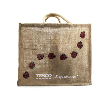 SWINDON, UK - FEBRUARY 1, 2014:  Tesco reuseable Bag for Life on a white background