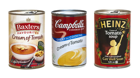 canned goods: SWINDON, UK - FEBRUARY 26, 2014: Three Tins of Tomato Soup On a White Background