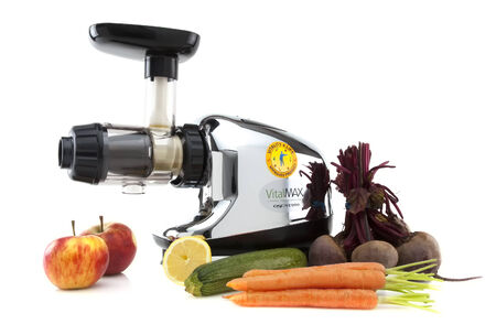 SWINDON, UK - FEBRUARY 16, 2014: Vital Max Juice Machine with Fruits and Vegtables on a White  Background