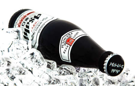 one people: SWINDON, UK - MARCH 2, 2014: Bottle of  Asahi Super Dry Beer on ice over a white background Editorial