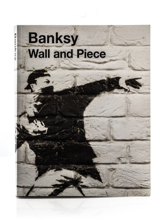 BRISTOL, UK - MARCH 15, 2014: Cover of Banksy book Wall and Piece showing man throwing flowers,   Publikacyjne