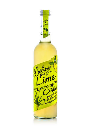 cordial: SWINDON, UK - MARCH 23, 2014: Bottle of Belvoir Lime and lemongrass Cordial on a white background