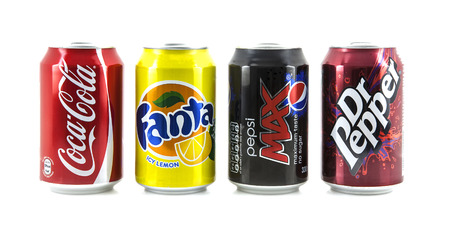 SWINDON, UK - MARCH 2, 2014: Four Popular drink cans on a white background, Coca-Cola, Fanta and Dr Peppe and  Pepsi represent the Worlds most popular soda drinks.