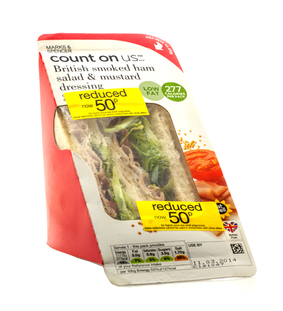 spencer: SWINDON, UK - MARCH 12, 2014: Reduced Smoked Ham Salad Sandwich from Marks and Spencer on a white background