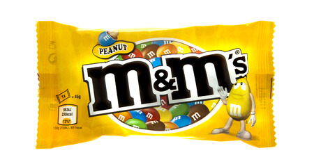 packshot: SWINDON, UK - MARCH 9, 2014: Packet of Peanut M&Ms milk chocolate made by Mars Inc. isolated on white background