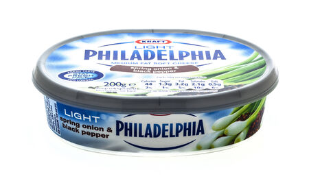 packshot: SWINDON, UK - MARCH 29, 2014: Philadelphia Medium Fat Soft Cheese with Spring onion & Black Pepper on a white background Editorial