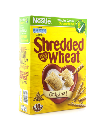 SWINDON, UK - MARCH 15, 2014: Box of Shreaded wheat cereal on white background, Shreaded wheat is made by Nestle