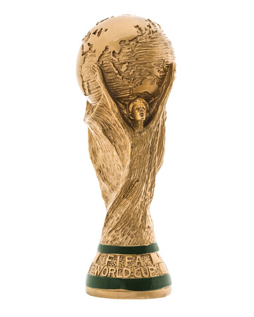 awarding: SWINDON, UK - JUNE 11, 2014: FIFA World Cup Trophy on a white Background,  FIFA World Cup Trophy, was introduced in 1974. Made of 18 carat gold with a malachite base