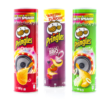 stackable: SWINDON, UK - OCTOBER 4, 2014: Three Tubes of Pringles Crisps om a White Background Editorial