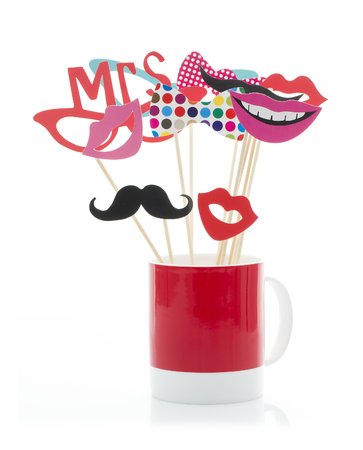 photo of accessories: Photo Booth Props in a Red Mug on a White Background Stock Photo