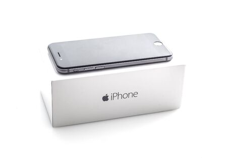 SWINDON, UK - NOVEMBER 15, 2014: Apple iPhone 6S in Space Gray with box on a white background the iPhone 6S is the new addition to the iPhone family Publikacyjne