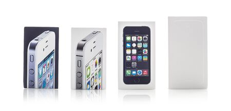 iphone5: SWINDON, UK - NOVEMBER 15, 2014: Colection of used Apple iPhone boxes on a white background showing the growth of the iPhone family from the iPhone 4 though to the new iPhone 6S Editorial