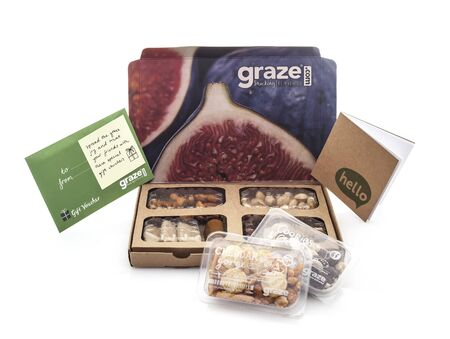 snacking: SWINDON, UK - NOVEMBER 5, 2014: Graze Snacking Box on a White background by graze.com snacking reinvented healthy snacks delivered to your door or work place
