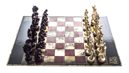 SWINDON, UK - NOVEMBER 15, 2014: Lord Of The Rings The Tow Towers Chess Set  on a white background