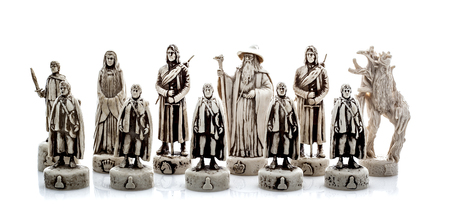SWINDON, UK - NOVEMBER 5, 2014: Lord Of The Rings Chess Set Figures on a white background