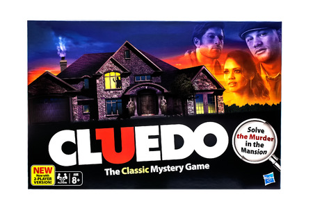 devised: SWINDON, UK - DECEMBER 2, 2014: Cluedo Classic murder mystery game for three to six players, devised by Anthony E. Pratt from Birmingham, England on a white background