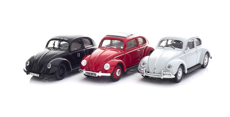 SWINDON, UK - DECEMBER 14, 2014:  Three Vintage VW Beetles  Die cast modesl on a white background.