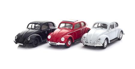 SWINDON, UK - DECEMBER 14, 2014: Three Vintage VW Beetles Die cast modesl on a white background.