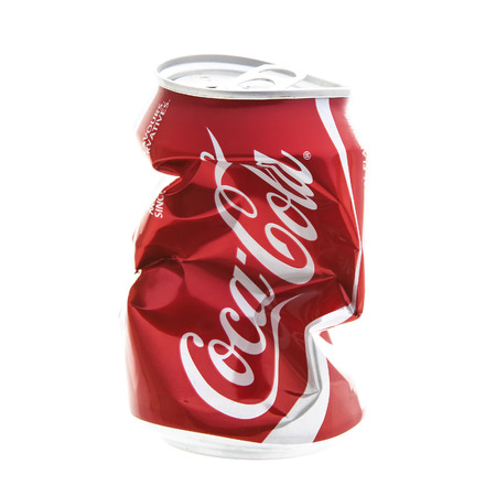 SWINDON, UK - DECEMBER 16, 2014: An Empty Dented and Crushed Can of Coca-Cola on a white background Redakční
