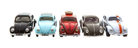 SWINDON, UK - DECEMBER 14, 2014: Five Old Retro VW Beetle Die cast models on a white background.