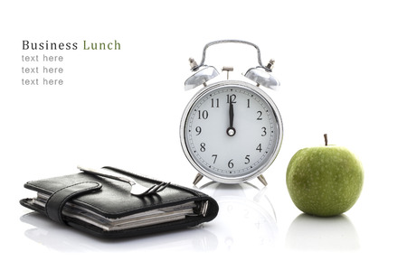 no time: Fork on Filofax with Apple and Clock but no time for lunch, Business lunch Concept on a White Background with Copy Space