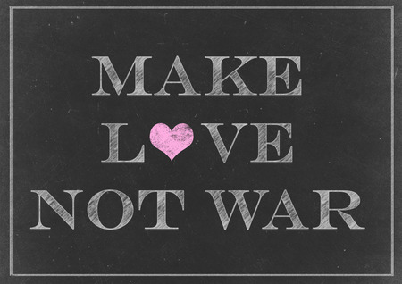 counterculture: Chalk drawing - make love not war - anti-war slogan commonly associated with the American counterculture of the 1960s