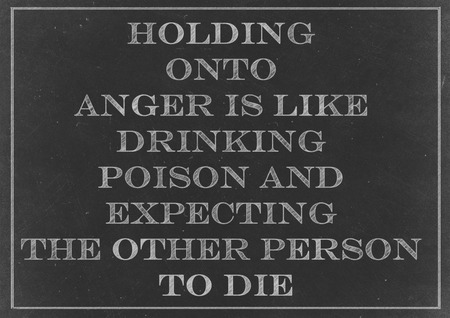 Chalk drawing - concept of Holding onto anger is like drinking poison and expecting the other person to die photo