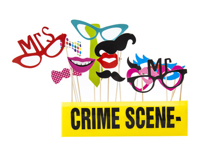 photo of accessories: Photo Booth Props on a White Background with Crime Scene Tape Stock Photo