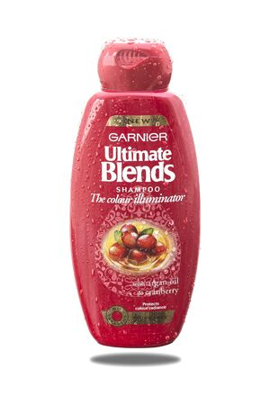 ultimate: SWINDON, UK - MAY 3, 2015: Garnier Ultimate Blends Shampoo With Argan Oil and Cranberry on a White .
