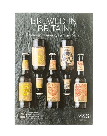 spencer: SWINDON, UK - AUGUST 2, 2015: Marks and Spencer Brewed in Britain, Exclusive Beers on a White Background