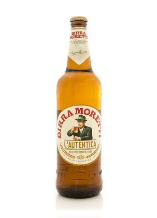 SWINDON, UK - AUGUST 8, 2015: Bottle of Birra Moretti, Premium Lager Beer on a White Background. Birra Moretti is a quality beer made in the traditional way, the result of a production process unchanged since 1859.