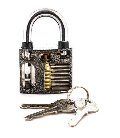 fey: Cut Away Padlock with keys showing how a Padlock Works on a White Background Stock Photo
