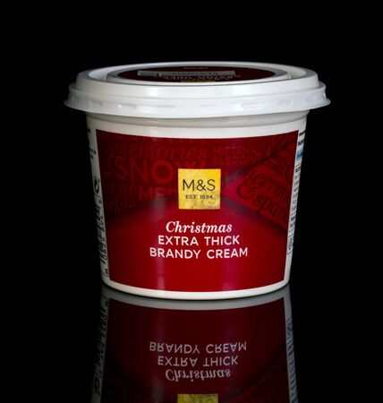 spencer: SWINDON, UK - DECEMBER 31, 2016: Marks And Spencer Christmas Extra Thick Brandy Cream on a black background