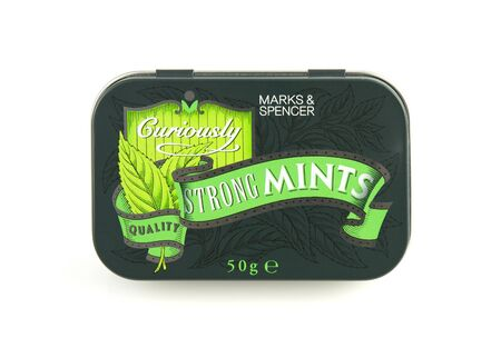 curiously: SWINDON, UK - JANUARY 1, 2017: Tin of curiously strong mints from Marks and Spencer
