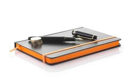 SWINDON, UK - JULY 2, 2017: Close up of a Mont Blanc fountain pen and notebook on a white background Editorial