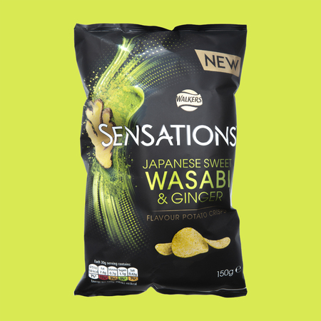 SWINDON, UK - MAY 13, 2018: Walkers Sensations Japanese Sweet Wasabi and Ginger Flavour Potato Crisps on a lime green background Publikacyjne