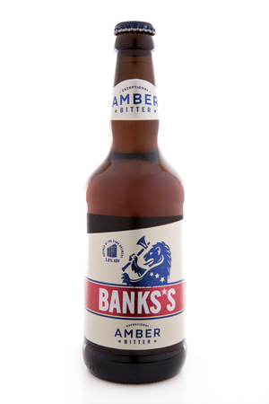SWINDON, UK - APRIL 08, 2018: Bottle of Banks's Exceptional Amber Bitter brewed at the park brewery on a white background Publikacyjne